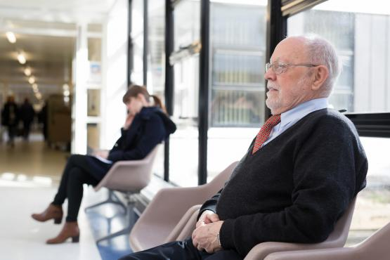 Man sitting in a waiting room in a hospital